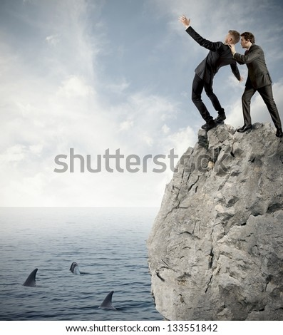 Concept of competition in business with falling businessman - stock photo