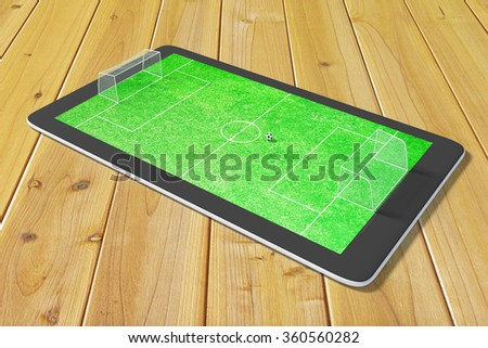 Concept of computer games in soccer at digital tablet - stock photo