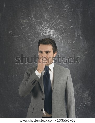 Concept of confused businessman with arrow on the head - stock photo