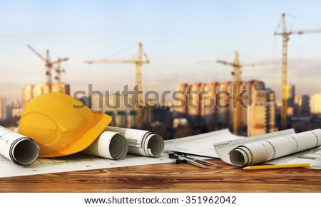 Concept of construction and design. 3d render of blueprints and designer tools on the panorama of construction site. - stock photo