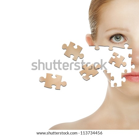 concept of cosmetic effects, treatment and skin care.  face of young woman of the particle puzzle - stock photo