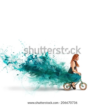 Concept of creative fashion with girl on bike - stock photo