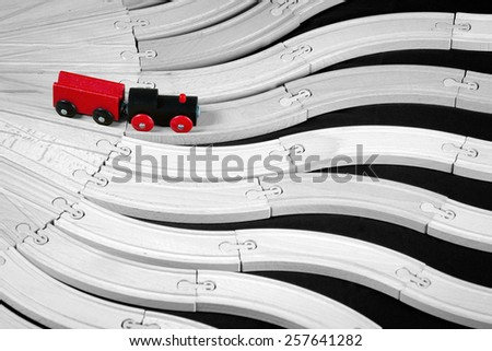 concept of decision making process - wooden toy train on the multiple rails intersect - stock photo