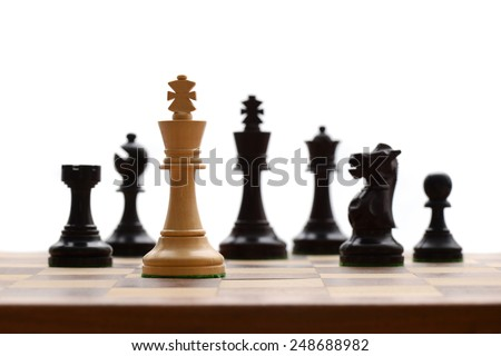 Concept of defeat (white king overpowered by black, camera focus on white king) - stock photo