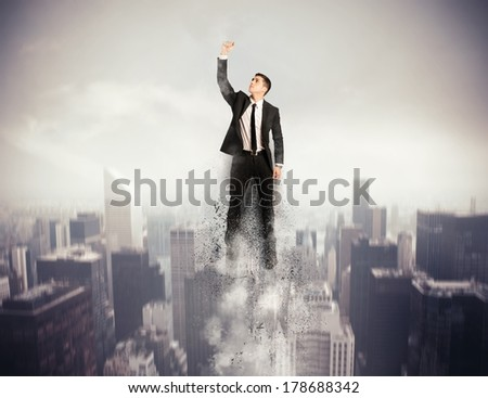 Concept of determination and success with flying Super hero businessman - stock photo