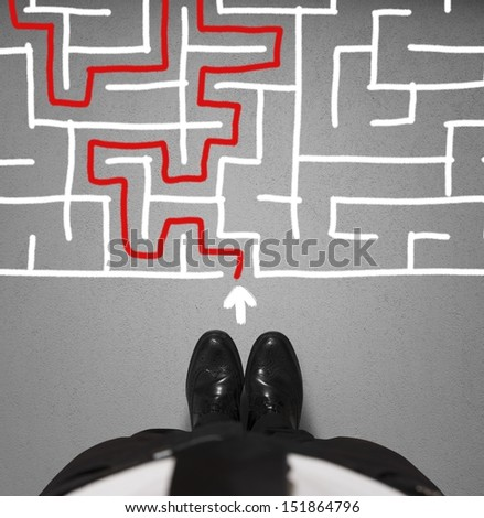 Concept of difficulty with businessman and maze - stock photo