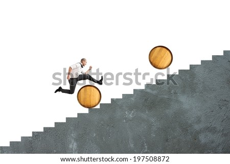 Concept of difficulty with businessman that jumps obstacles - stock photo