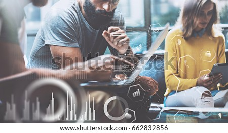 Concept of digital diagram,graph interfaces,virtual screen,connections icon.Young entrepreneurs people working at modern office.Man using contemporary laptop,blurred background.Horizontal