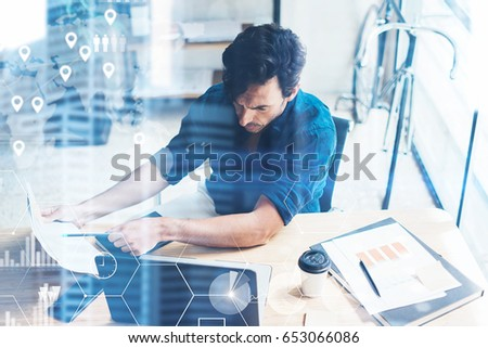 Concept of digital screen,virtual connection icon,diagram,graph interfaces.Businessman working at office place on modern laptop.Young man analyze stock reports.Blurred background,horizontal