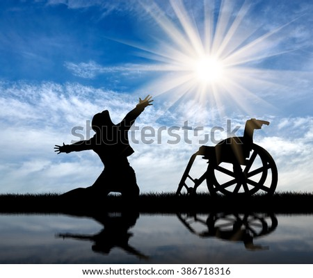 Concept of disability and positive. Silhouette happy disabled on a sky background and reflected in water
