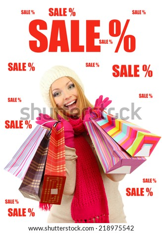 Concept of discount. Attractive young woman with shopping bags, isolated on white - stock photo