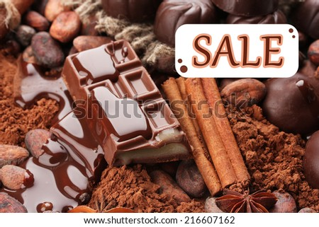 Concept of discount. Composition of chocolate sweets - stock photo