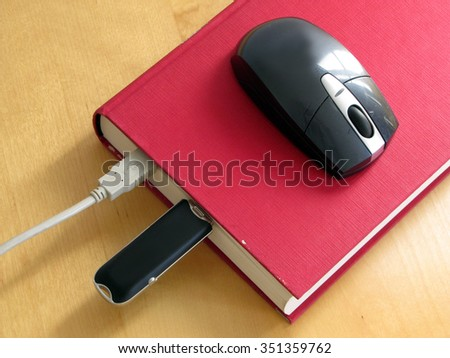 Concept of e-book. Book and mouse - stock photo