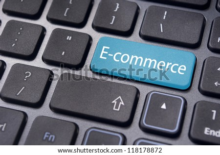 concept of e-commerce or ecommerce, electronic commerce, with message on computer keyboard.