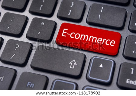 concept of e-commerce or ecommerce, electronic commerce, with message on computer keyboard. - stock photo