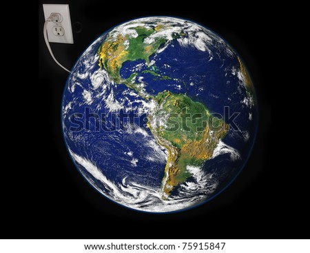 Concept of Earth plugged in electric outlet image courtesy NASA via public domain images. - stock photo