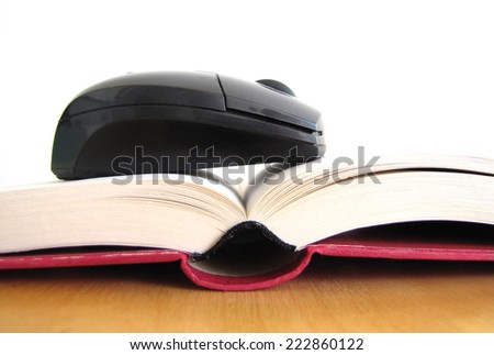 Concept of ebook. Book and mouse - stock photo