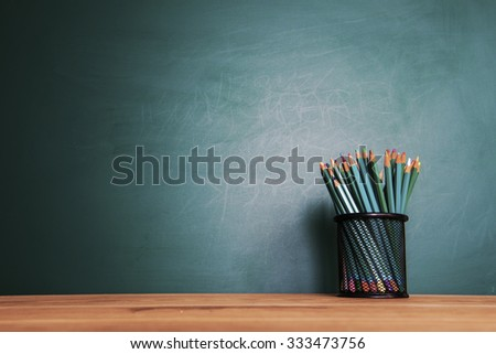 Concept of education or back to school on green background - stock photo