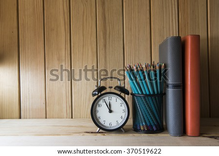 Concept of education or back to school on wooden background - stock photo
