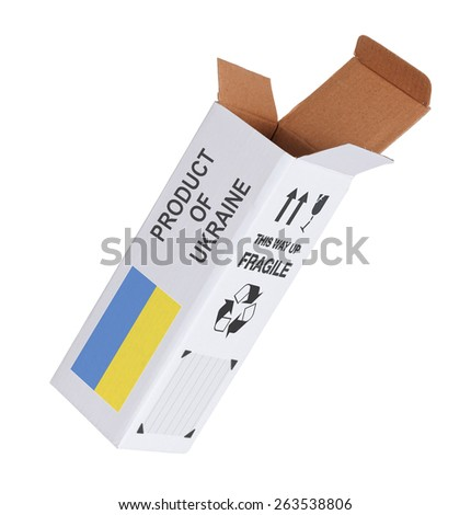 Concept of export, opened paper box - Product of Ukraine - stock photo