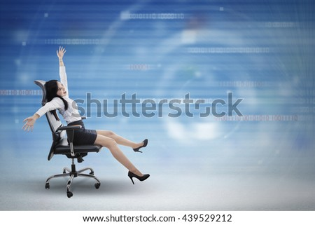 Concept of fast internet connection with a young businesswoman driving chair inside cyberspace - stock photo