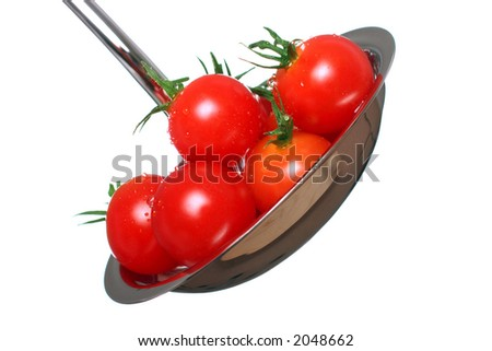 concept of fresh, just picked tomatoes going into a tomato soup - stock photo