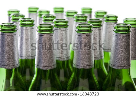 Concept of Glass Recycling or Alcohol Production - Green Glass Bottles Isolated on White - stock photo