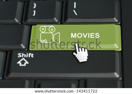 Concept of go to movies call to  action. The focus is on the enter key with the shift button on the bottom - stock photo