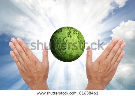concept of green globe on shining beam sky.
