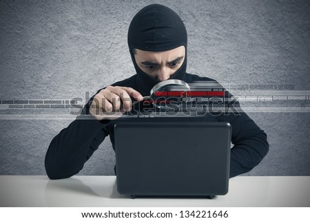 Concept of hacker at work with lens - stock photo