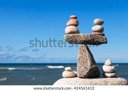 Concept of harmony and balance. Balance stones against the sea. Rock zen in the form of scales - stock photo