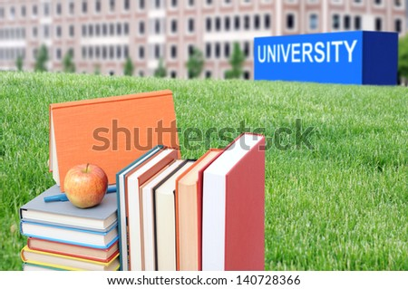 concept of higher education: book, campus, university - stock photo