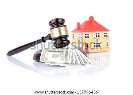 Concept of house sale with gavel and money - stock photo