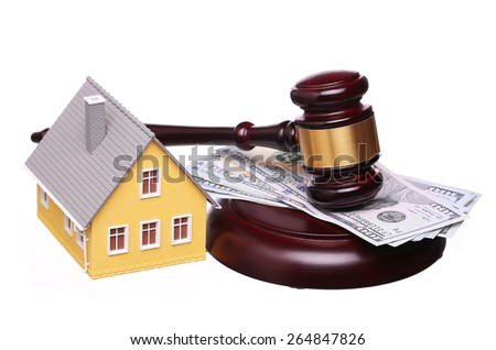 Concept of house sale with gavel and money isolated on white. Foreclosure - stock photo