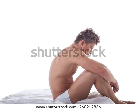 Concept of impotence. Upset man sitting in bed - stock photo