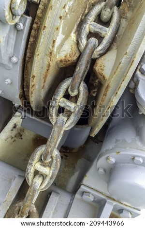 Concept of interdependence: Links of steel chain on commercial fishing boat - stock photo