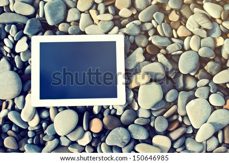 concept of internet and communication. blank empty tablet computer on the beach
