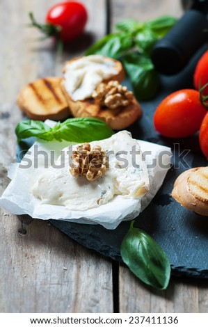 Concept of Italian food with gorgonzola, bread, wine, tomato and basil, selective focus - stock photo