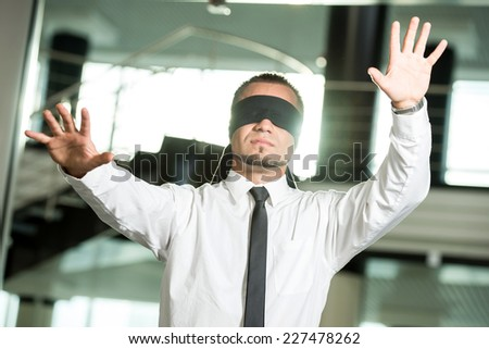 Concept of job search.  Portrait of young man blindfolded. - stock photo