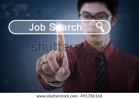 Concept of Job Search. Young businessman touching a job search button on the virtual screen