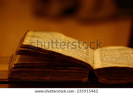 concept of knowledge, vintage book candle - stock photo