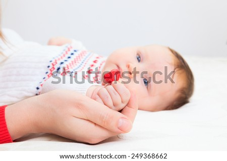 concept of love and family. hands of mother and baby closeup