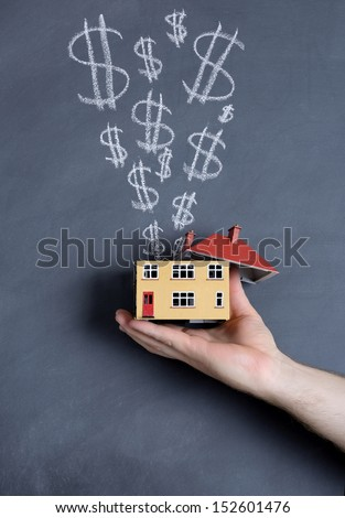 concept of making money from a house - stock photo