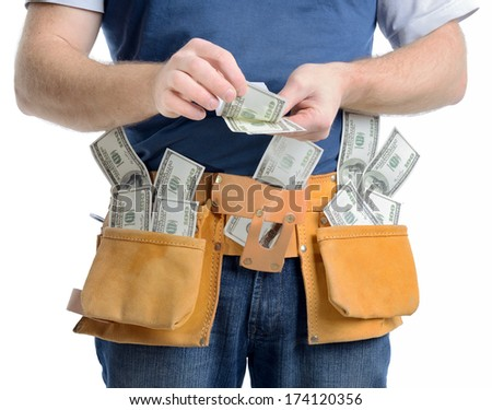 Concept of making money in the construction building trade,  a man counting money isolated on a white background - stock photo