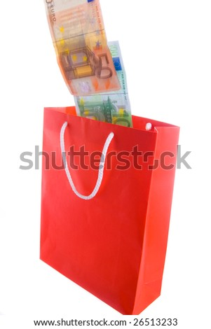 Concept of money falling in shopping bag. Blur on banknotes for motion. - stock photo