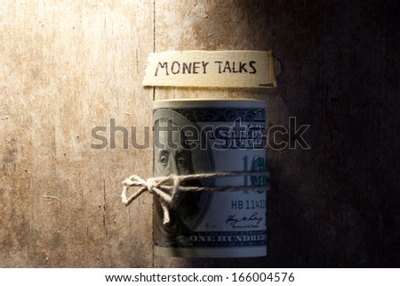 "Concept of money talks, money and inscription ""Money talks"" - stock photo"