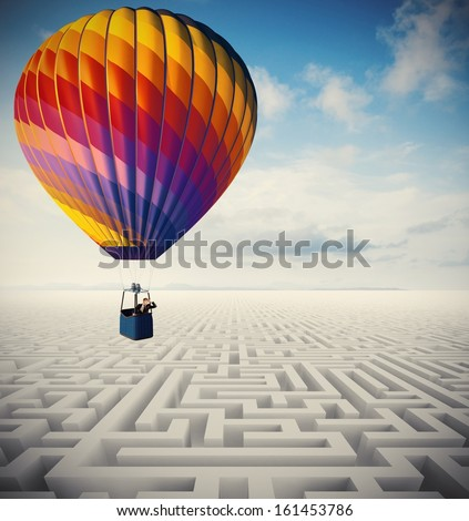 Concept of overcome obstacles with businessman on a hot air balloon - stock photo