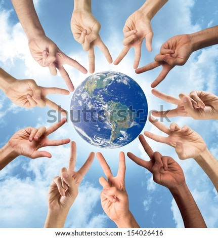 Concept of peace and multiracial with hands. World provided by Nasa - stock photo