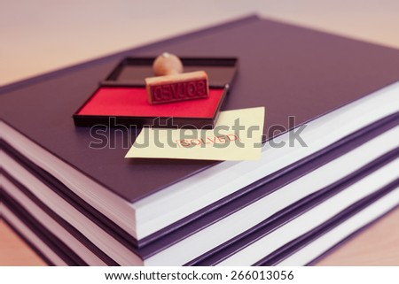 Concept of problem solution: stamp inscription of word 'solved'  on the pile of books - stock photo