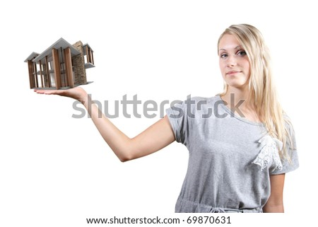 concept of real estate business: woman with house small on the hand